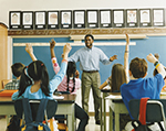 A teacher stands in front of a classroom full of students.