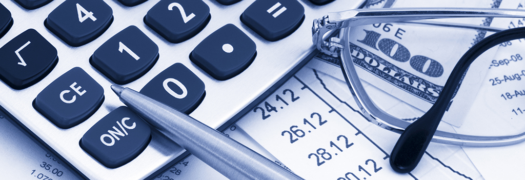 A calculator and a group of papers related to calculating cost-benefit ratio.