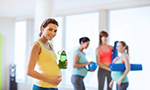 A group of pregnant women participate in low impact aerobic exercise.