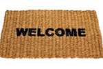 A door mat that reads 'welcome'.
