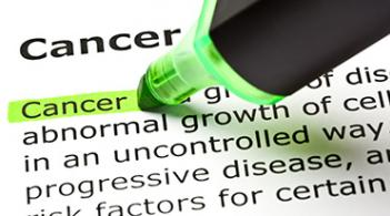 A green highlighter marks over the definition of cancer