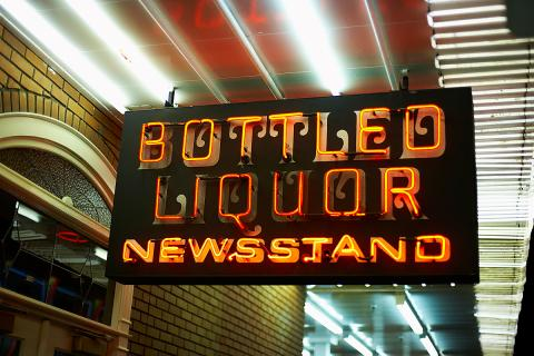 A neon sign advertising bottled liquor