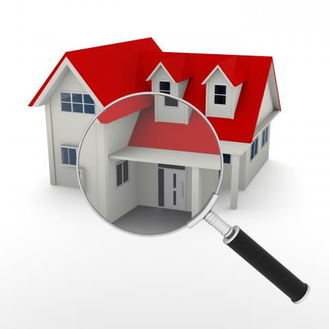 model home with a magnifying glass in front