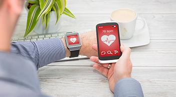 A wrist-worn activity monitor sends information to a smartphone.