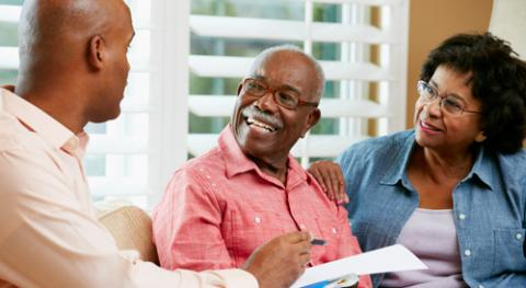 A community health worker meets with a senior couple
