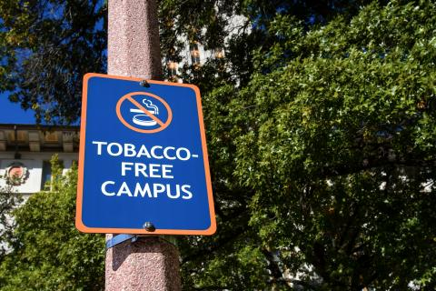 A blue sign with white lettering reads Tobbacco Free Campus.