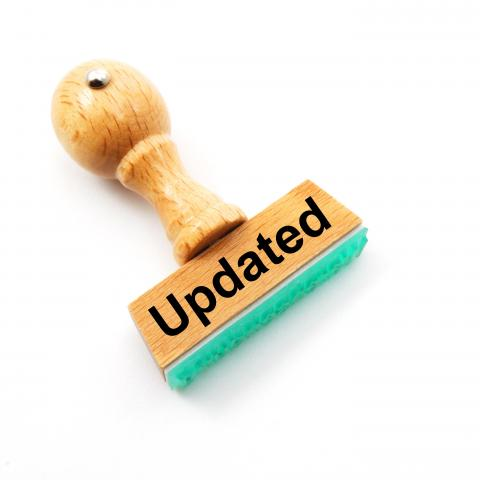 "A rubber ink stamp labeled with the word ""Updated"""
