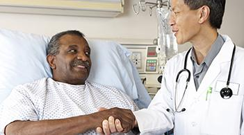 A doctor meets with a patient prior to a colonoscopy.